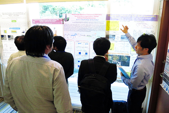 Mr. Kota Nabeya presenting his poster (right-hand side).