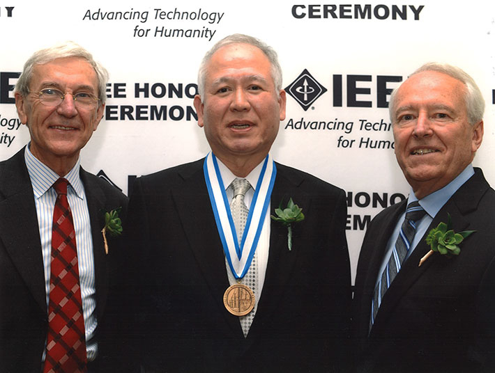 Akagi with IEEE President James A. Jefferies (right) and IEEE President-elect Jose M.F. Moura